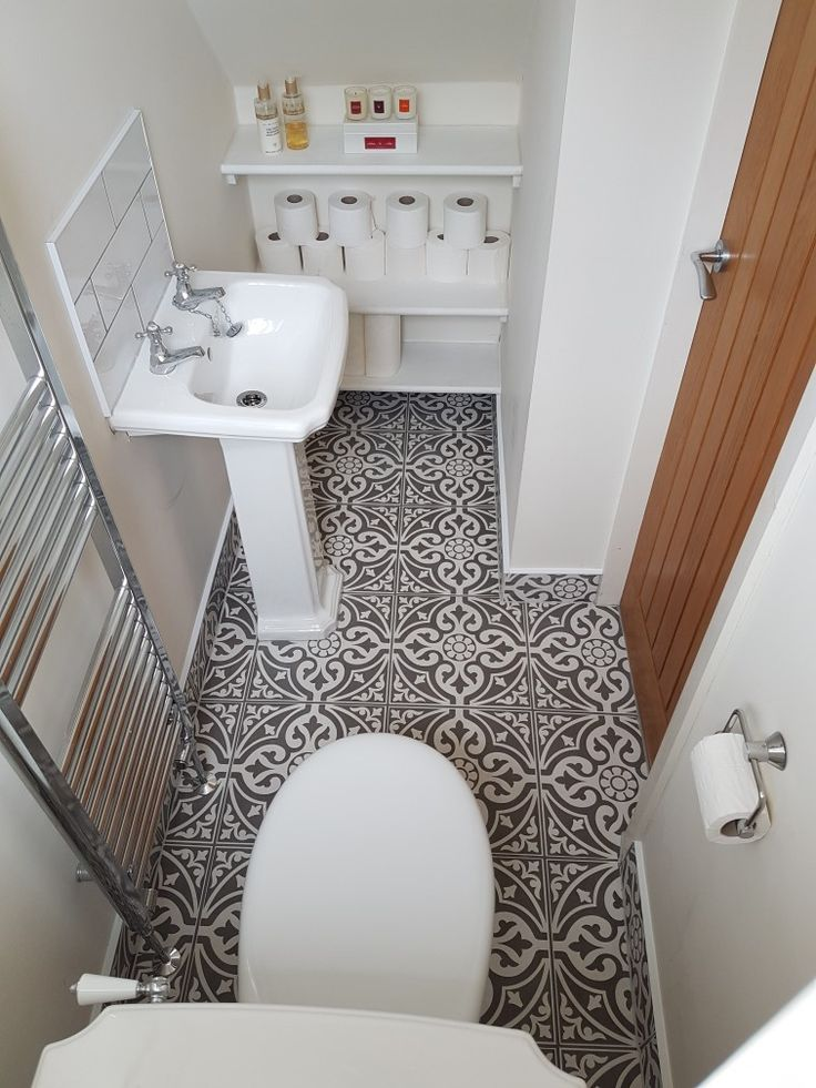 Compact w/c with traditional style toilet and basin. White subway tile and Laura Ashley Devonstone floor tile.