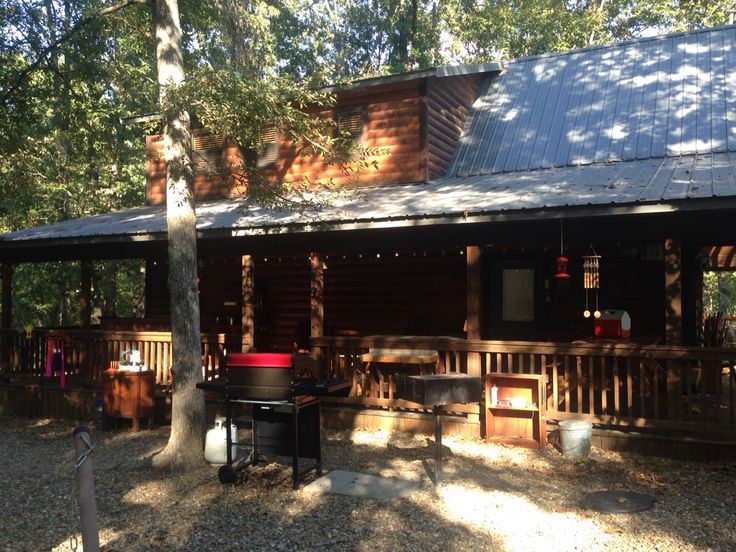 Side porch of old glory cabin with 6 person hot tub for Atv parks in texas with cabins