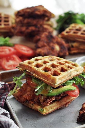 Fried chicken and waffle sandwiches with bacon cheddar and green onion waffles. Oh man.