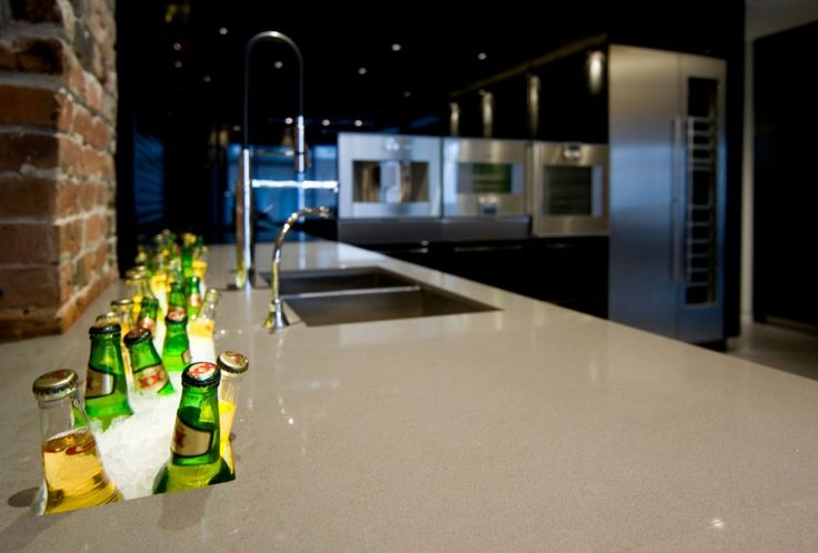 bachelor pad: Yaletown Loft Designed by Kelly Reynolds, Yaletown Loft KItchen Countertop with Ice Crevice for Beer Designed by Kelly Reynolds