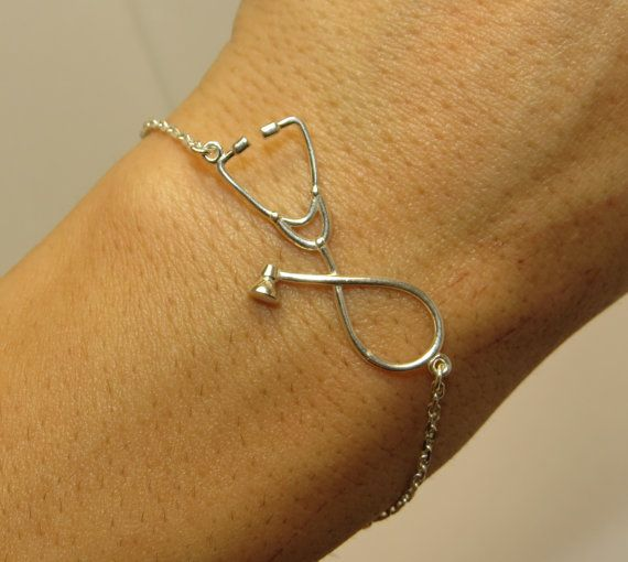 The first thing that I associate with hospitals and doctors is a stethoscope! This universal symbol of medicine could become the best gift to a doctor, medical student, intern or somebody who is somehow connected with medicine or fond of it.  Delicate but tight-knit in every line, this silver stethoscope bracelet will meet the most exquisite demand!!!! Adjustable 6 -7.5 inches  Metal: sterling silver 925 (Rhodium plated)/ 14K Gold Filled size: pendant 3 cm weight: 2.75 gr  Special care for…