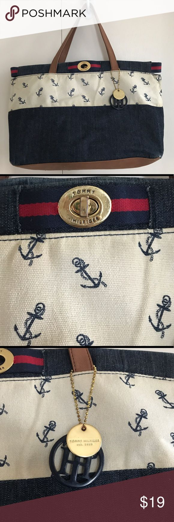 Tommy Hilfiger Nautical Tote Bag Tommy Hilfiger Nautical Tote Bag. This bag is clean and was well cared for. The bottom has a few spots of wear and is pictured. The bag is mostly denim. Tommy Hilfiger Bags Totes