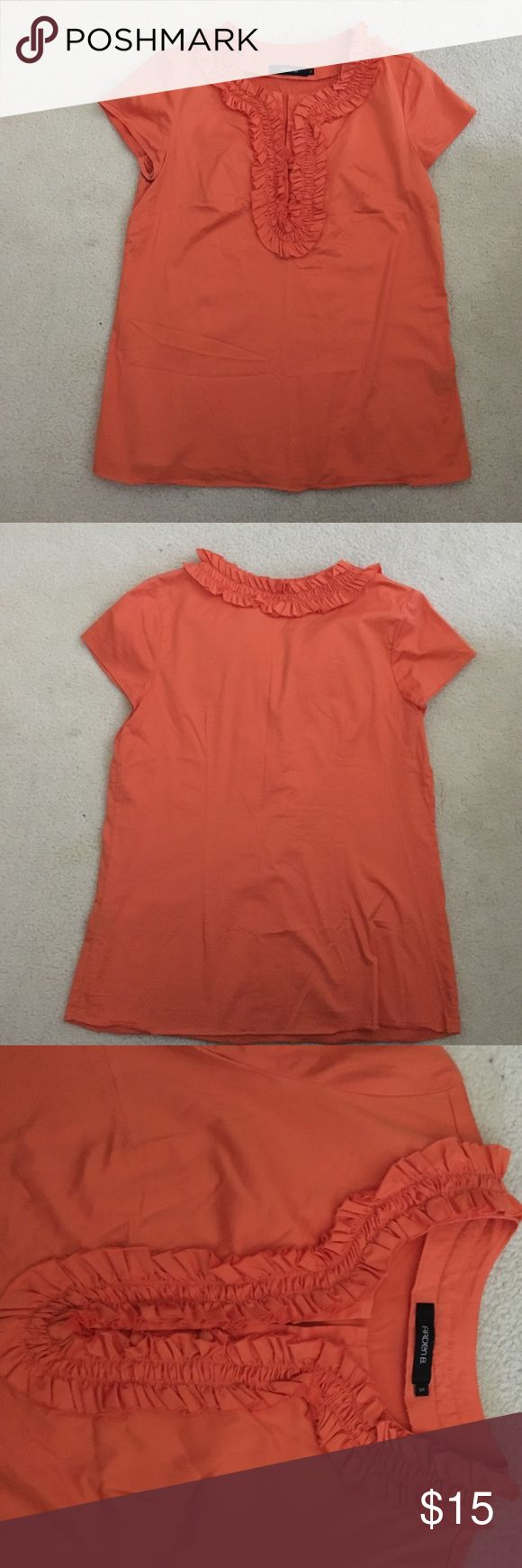 EUC Arden B. Orange Short Sleeve Top EUC Arden B. Orange Short Sleeve Top. With the material runxjed around neck line and down the front of the top (just about half way). The runched material near busy does have a few buttons to keep material together! Size Small Arden B Tops Tees - Short Sleeve
