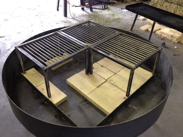 """3 Small grills on a 48"""" diameter table."""