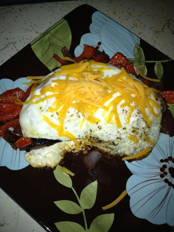 Fried hard eggs over fried onion and peper