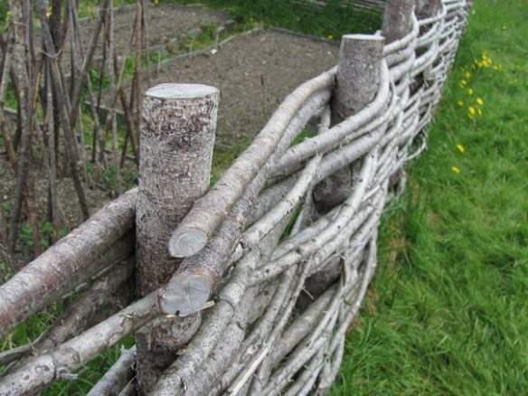 I hate when I see branches in trash bins by the street. Making a trellis or wattle fence from tree scraps is a beautiful and functional alternative.