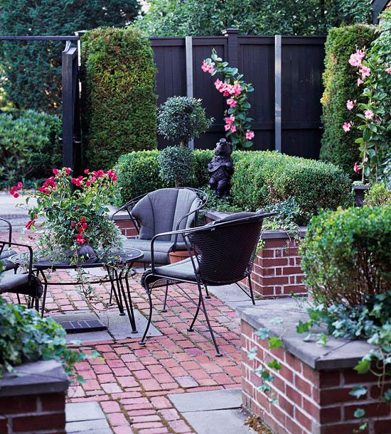 private oasis: Gardens Ideas, Brick Patio, Black Fence, Outdoor Spaces, Brick Planters, Brick Courtyards, Wrought Irons, Patio Ideas, Irons Tables