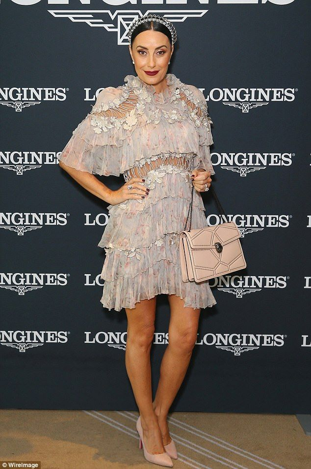 Shoe-in for best dressed?Shoe designer Terry Biviano upped the fashionista stakes at Royal Randwick's Championship Race Day, stunning in an intricately detailed Zimmerman gown