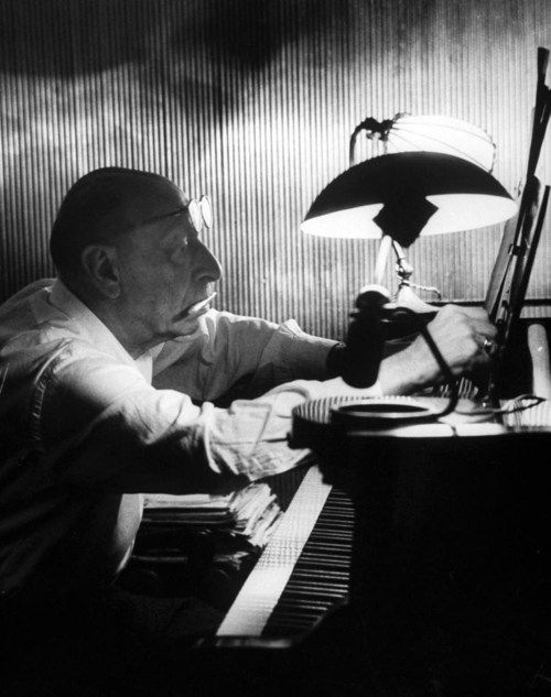 Composer Igor Stravinsky working at a piano in an empty dance hall. Photograph by Gjon Mili. Venice, Italy, 1957.
