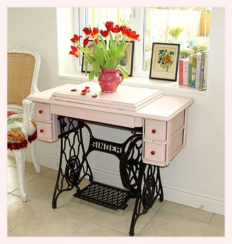 Vintage singer sewing table - we use one of these as a side table. I never thought about painting it though