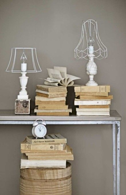 love these stacks of books and white lamps