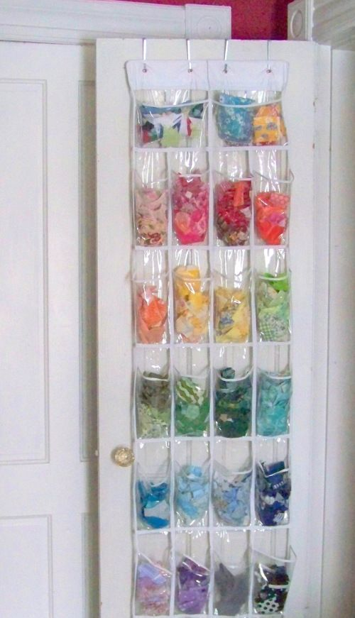 An idea for organizing fabric scraps: throw them in a hanging shoe sorter!