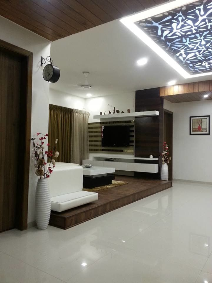 Browse images of modern Living room designs: SURYAM. Find the best photos for ideas & inspiration to create your perfect home.