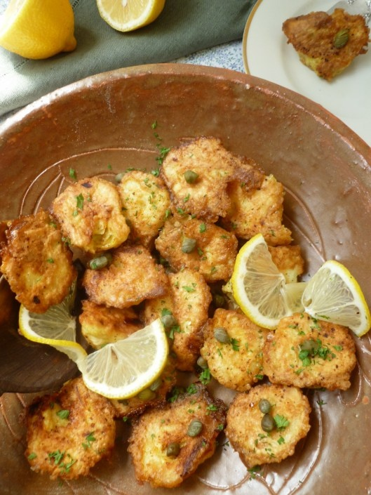 sauteed artichoke hearts with white wine, lemon and capers. Kind of like Artichoke picatta.