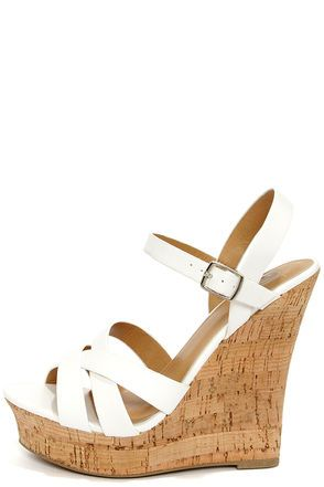 My Delicious Serum White Peep Toe Wedge Sandals: Whats the magic elixir for a wardrobe lean on wedges? These of course! White vegan leather straps crisscross over a cute peep toe and adjust at the ankle with a silver buckle. Cork-wrapped wedge heel in beige slide into a toe platform for plenty of lift. Cushioned insole. Nonskid rubber sole 5.5 $28.00
