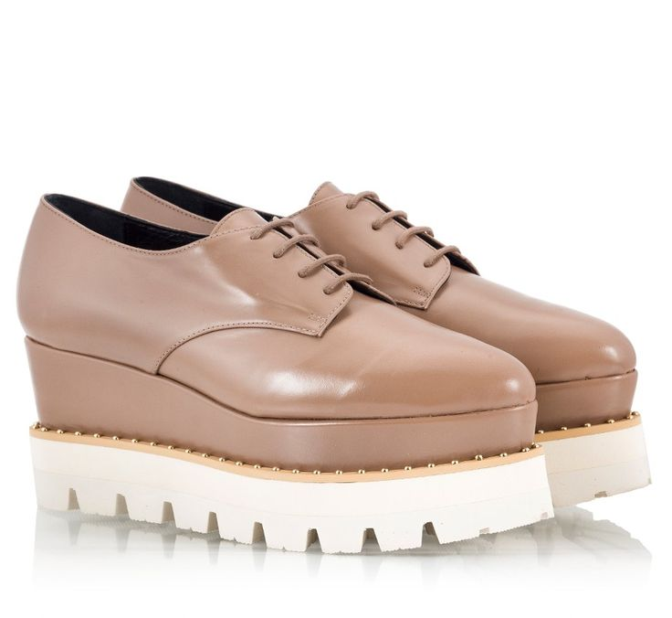 Paloma Barcelo derby wedges in beige vitello leather upper. Inspired by Italian-made brogues are set on a leather covered wedge heel with a chunky white rubber 'tractor' sole.