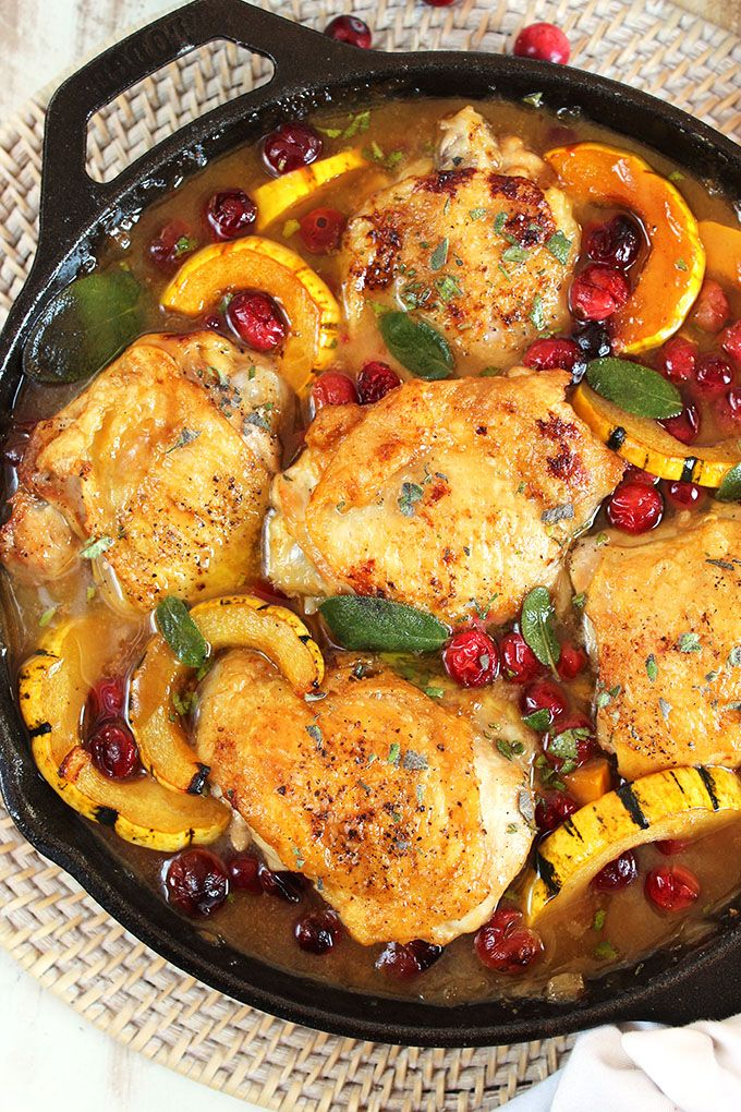 Quick and easy, Maple Mustard Chicken Skillet with Cranberries and Delicata Squash recipe is the one pot meal your family will want all season long. Kid friendly...husband approved! | @suburbansoapbox