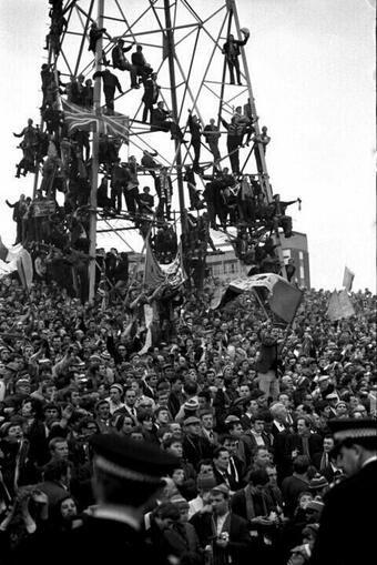Rangers fans climb the floodlight pylon for a better view, at St James Park Newcastle 1969