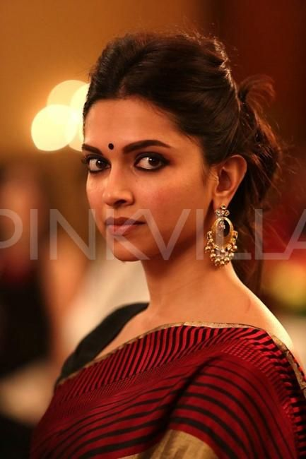 Love this look! Deepika's makeup, earrings, hair, and sari on fleek!