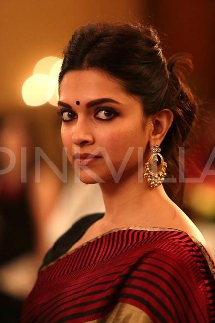 Love this look! Deepika's makeup, earrings, hair, and sari on fleek!