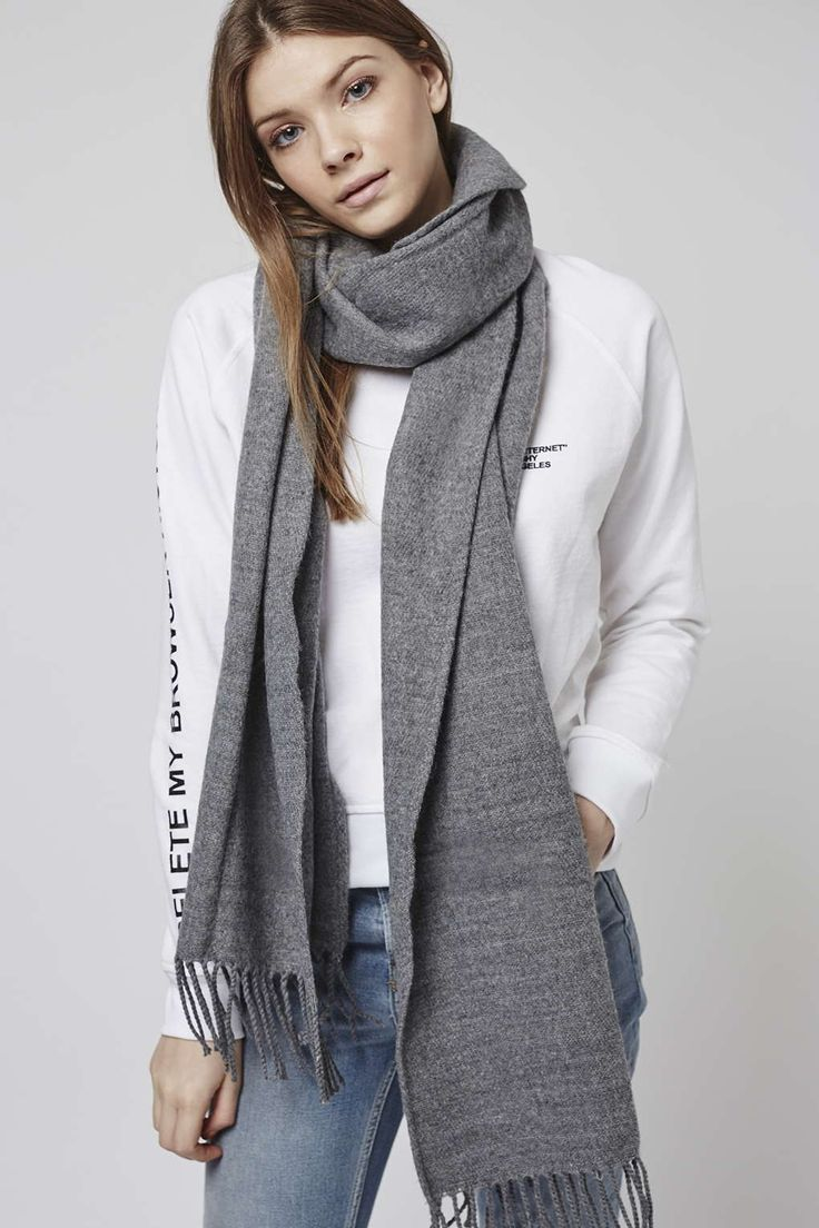 Our super-soft tassle scarf is the perfect neutral accessory for wrapping up in this season. #Topshop