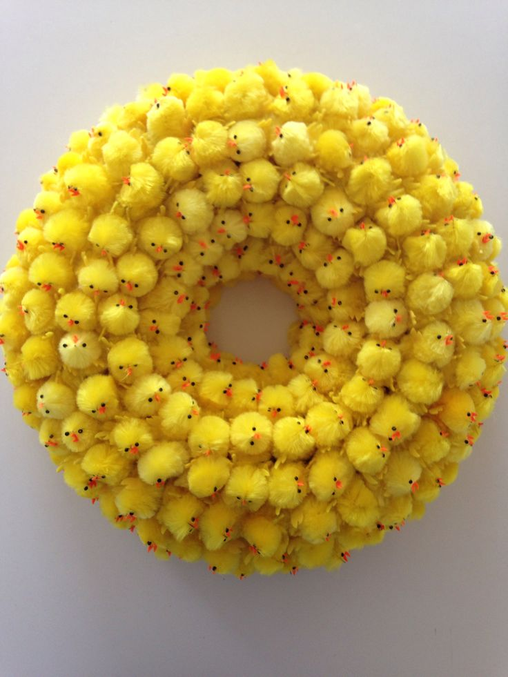 good idea - wreath made with those fuzzy chicks, doesn't need to be this big, one or two rows would be cute.