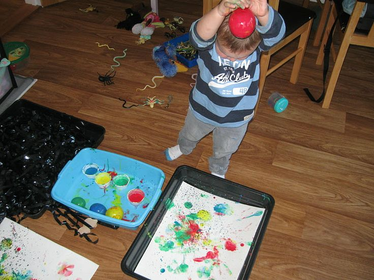 dip balloons with part air/part water into paint and have child drop it to paint on paper!!!