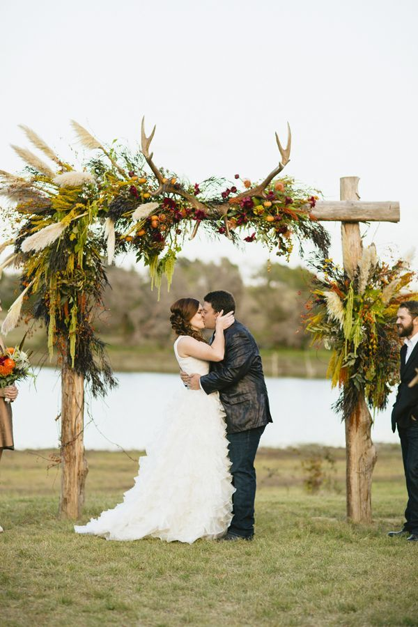 rustic wedding ceremony arch with antlers for fall wedding