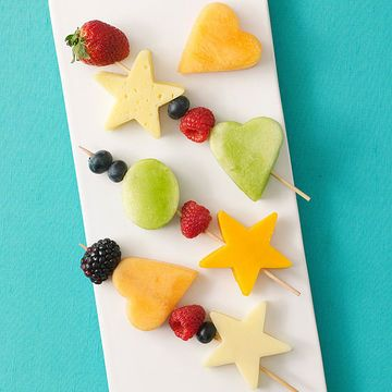 """The protein in this kid-friendly snack keeps energy levels high until dinnertime. We like to stick salt-free pretzel sticks into cubes of low-fat cheese to make """"satellite snacks,"""" but you can also make cheese more interesting to kids by cutting it into fun shapes with a cookie cutter and making kabobs with your favorite fruit."""