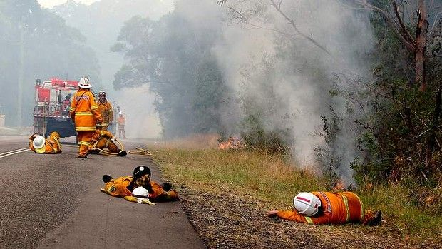 Exhausted firefighters takes a rest in Cragan Bay Road Nords Wharf. Oct 2013 Australia