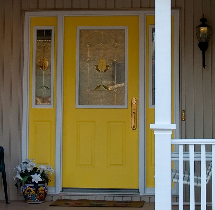 yellow front door with sidelights painted to match for