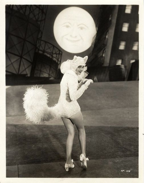 Cats in Apparel, Costuming, Photography and Film: Ruby Keeler (1910 – 1993) was a Canadian-born American actress, dancer and singer most famous for her on-screen coupling with Dick Powell in a string of successful early musicals at Warner Brothers, particularly 42nd Street (1933). From 1928 to 1940, she was married to singer Al Jolson. She retired from show business in the 1940s but made a widely publicized comeback on Broadway in 1971