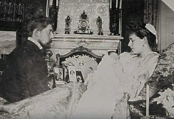 Maria and Ferdinand of Romania with an infant Carol