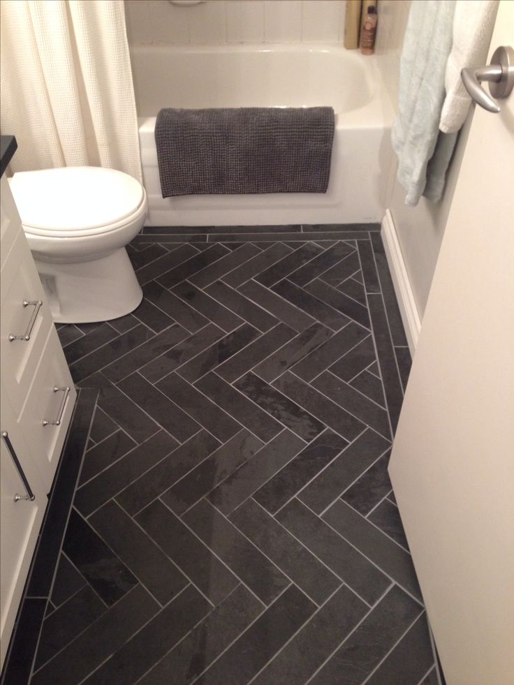 Charcoal Gray Herringbone, Honed Marble Floors in the Bathroom. www.houseandleisure.co.za loves this