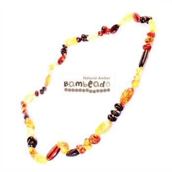 Looking for something unique? This gorgeous premium amber necklace comes in a combination of bean shaped and rounded beads in a mixed pattern of colours. Amber beads are finished in a polish compared to the standard bud range. The amber necklace is approx 50 cm in length.     The Bambeado comes together with a plastic screw clasp. While Bambeado amber comes in several colours, the colour is just a matter of personal choice.