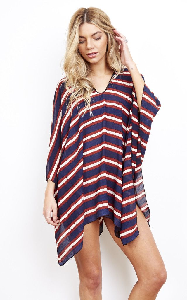 Stripes are never out of fashion. Add this timeless kaftan to your holiday wardrobe. Light-weight and with open arms, this throw-over will be worn time and time again. Perfect over a bikini or paired with shorts.