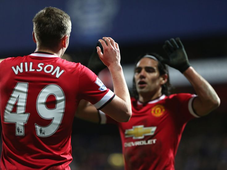 Colombian Radamel Falcao congratulates his @manutd teammate James Wilson after the latter's goal against QPR in January 2015.