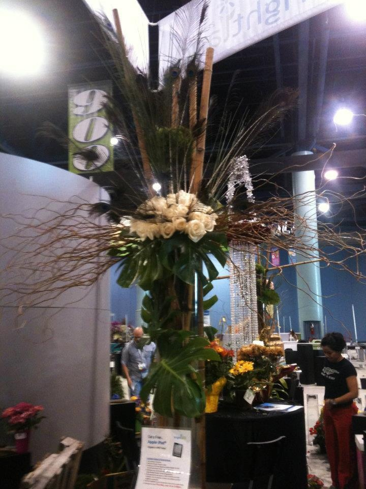 Tall centerpiece with tropical foliage polynesian party