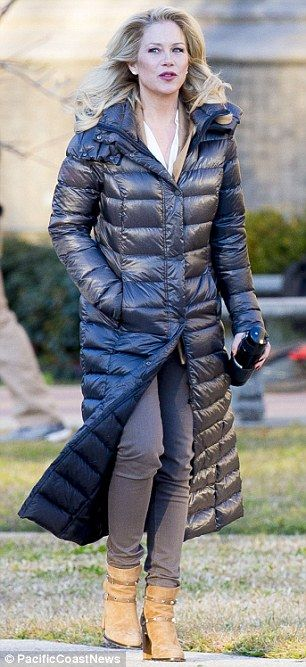 Bundled up: When they weren't filming, Christina and Mila wore bulky padded coats, and Mil...