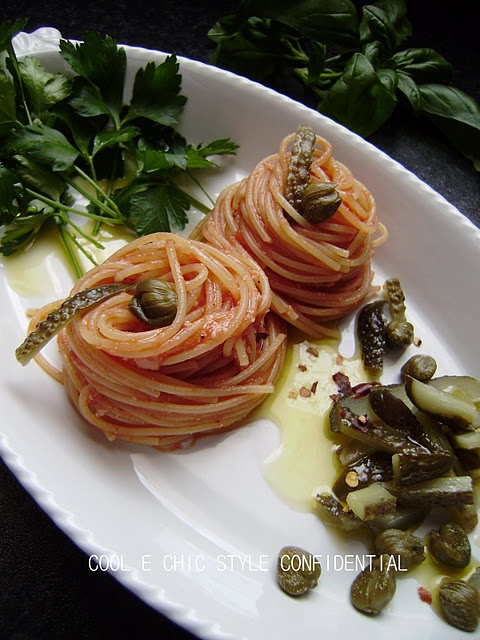 Spaghetti  alla puttanesca    A sauce made famous during WW 2 by Italian women displaced during the war cooked many a meals for our GI's  Grazie