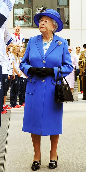 The Queen wore a cobalt blue jacket and matching hat to meet some of the taller members of Great Britain's Olympic team.