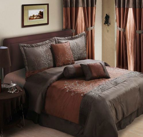 Dark brown and burnt orange bed set with decorative tree accents