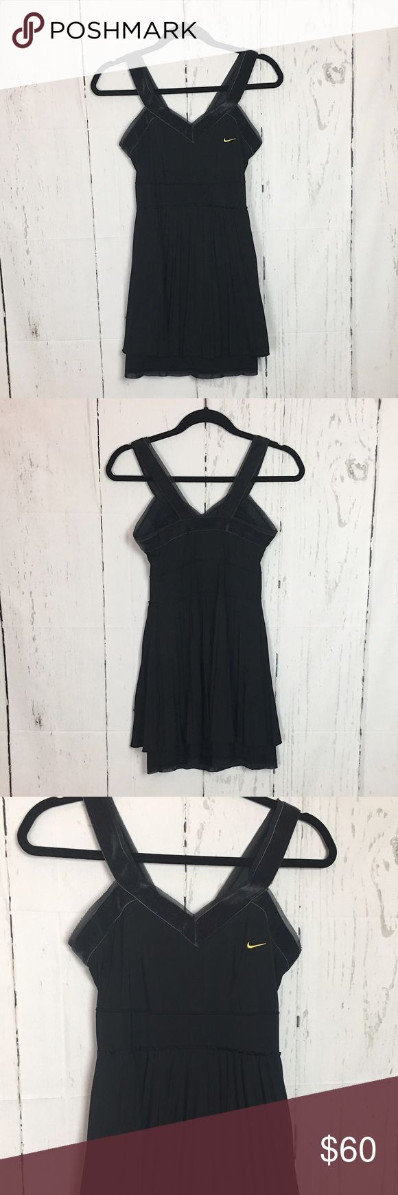 """NIKE MAria Sharapova 2008 US OPEN TENNIS DRESS blk Nike dress Maria Sharapova would've worn at the 2008 US Open with Velvet trim neckline and pleated empire waist overskirt, UV Protective and ultra lightweight, Nike Dri-FIT fabric to wick away sweat and help keep you dry and comfortable.  Built-in support bra for a great fit. Bonded seams, Embroidered Swoosh design trademark at left chest  Simply stunning! measurements: Armpit to armpit: 15"""" Waist: 13"""" Overall length: 31.5"""" Nike Dresses Mini"""