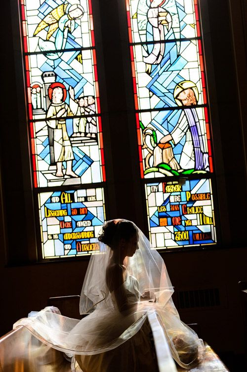 Beautiful photo of the bride in church, photos by Susan Stripling Photography via junebugweddings.com