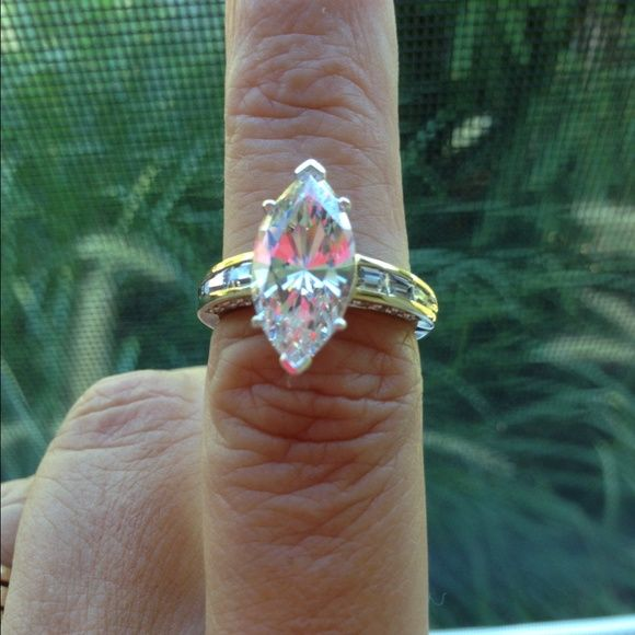 """ABSOLUTE DIAMOND ENGAGEMENT RING New 3 carat marquise absolute diamond beautiful!!! Bought from HSN.  Color Choices:Sterling Silver (rhodium-plated) or Vermeil (rhodium-accented) Size Choices:5, 6, 7, 8, 9 or 10 Measurements:Approx. 13/16""""L x 7/8""""W x 5/16""""H; shank 1/8""""W Metal Stamp:.925 Finish:Polished Country of Origin:China Packaging:Boxed Stone Information (all sizes and weights approximate) Total Carat Weight:6.46ct Clear Absolute Simulated Diamonds:Marquise (18x9mm); 5.5ct…"""