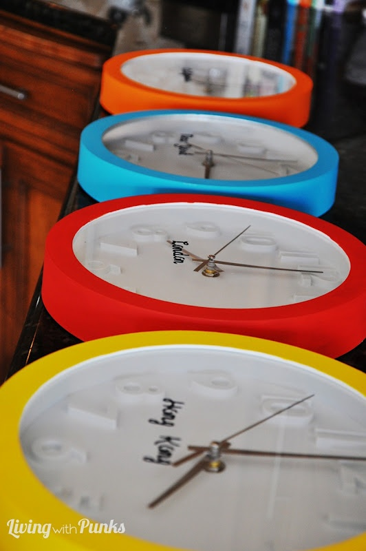 DIY Colorful Chronological Clocks...with different time zones! California, New York, London and Hong Kong. Hang in Laundry room to pass the time ;)