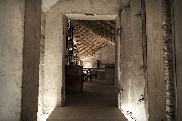 nestled within a mountain cave, shanghai godolphin creates a warm   welcoming wine tasting experience in a bunker once used to store national treasures.