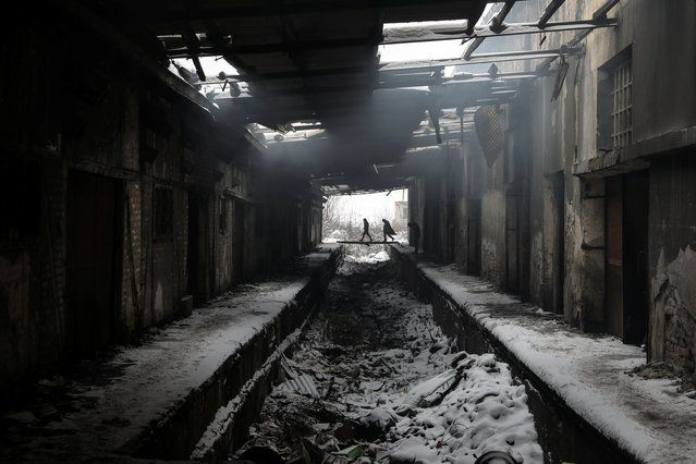 Migrants walk during a snowfall inside a derelict customs warehouse in Belgrade, Serbia, January 11, 2017. (Photo by Marko Djurica/Reuters)