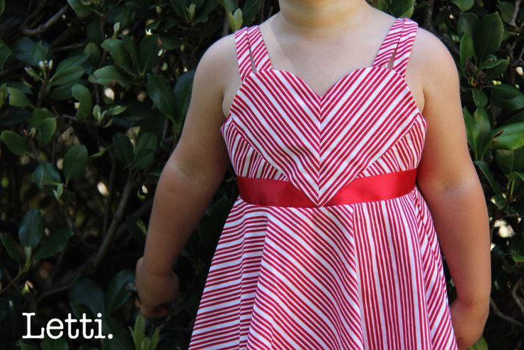 Candy Cane Dress.  This Dress is Candy Cane inspired Perfect for the Holiday Season!   The very Loveable Heart detailed bodice and Red Satin Bow give the outfit a Fun Festive feel.  www.letti.com.au