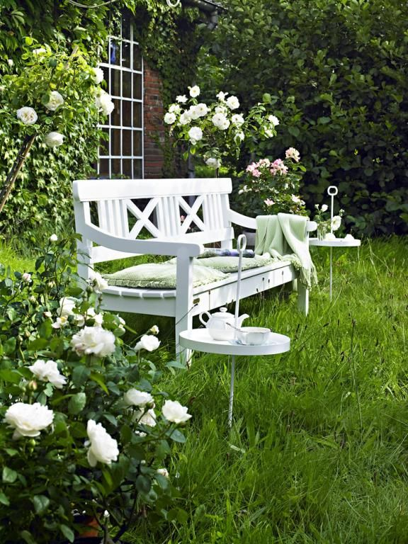 A white bench in the garden